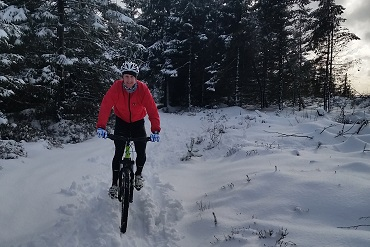 Cheshire CAT cyclists Mountain Biking in the snow at Llandegla